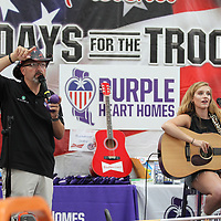 Scott Burns is joined by Auburn McCormick Friday at The Mall at Barnes Crossing they work to raise money for Burns' charity 7 Days for the Troops.