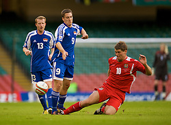 CARDIFF, WALES - Saturday, October 11, 2008: Wales' Sam Vokes and Liechtenstein's Thomas Beck during the 2010 FIFA World Cup South Africa Qualifying Group 4 match at the Millennium Stadium. (Photo by David Rawcliffe/Propaganda)