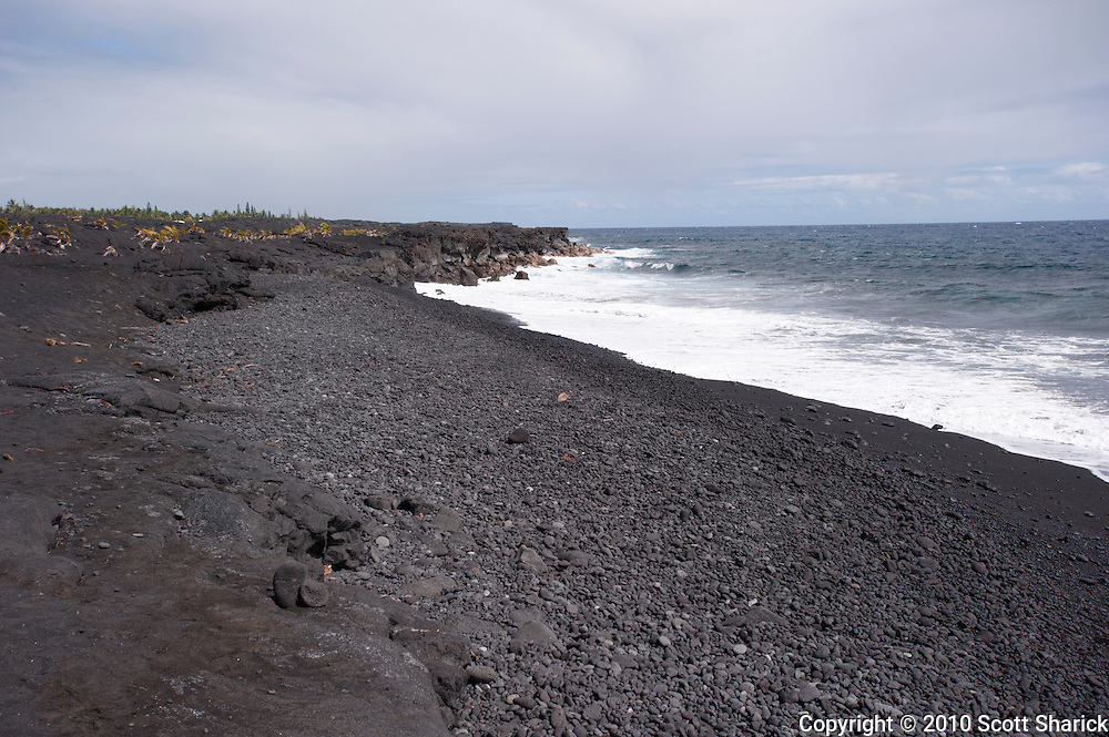 A new black sand beach being formed on the Big Island of Hawaii from a lava flow.