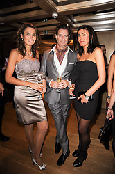 Left to right, OLIVIA COLE, RICHARD HAINES and JOANNE BLACK at a dinner hosted by jewellers Damiani at The Connaught Hotel, London on 3rd February 2010.