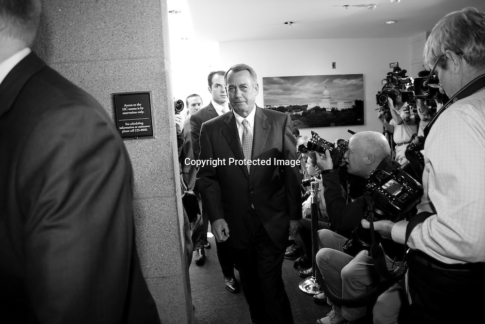U.S. House Speaker John Boehner (R-OH) departs after a House Republican caucus meeting at the U.S. Capitol in Washington, October 16, 2013. Speaker of the U.S. House of Representatives Boehner said on Wednesday that his chamber will not block the Senate plan to end the government shutdown and raise the federal debt.