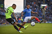 Peterborough United Midfielder, Joe Ward (15) and Portsmouth Defender, Nathan Thompson (20) during the EFL Sky Bet League 1 match between Portsmouth and Peterborough United at Fratton Park, Portsmouth, England on 30 April 2019.