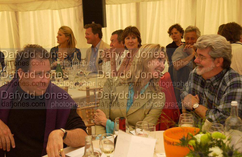 Lord Linley, Allegra Hicks and  George Lucas, Cartier Style Et Luxe, Goodwood, 27 June 2004. SUPPLIED FOR ONE-TIME USE ONLY-DO NOT ARCHIVE. © Copyright Photograph by Dafydd Jones 66 Stockwell Park Rd. London SW9 0DA Tel 020 7733 0108 www.dafjones.com