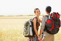 Hiking couple standing in field