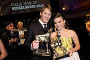 NFF - Nederlands Filmfestival - uitreiking van de Gouden Kalveren in Tivolli Utrecht.<br /> <br /> op de foto:  Winnaar Beste Acteur Gijs Naber voor zijn rol in de film Aanmodderfakker, Beste Actrice Abbey Hoes voor haar rol in Nena