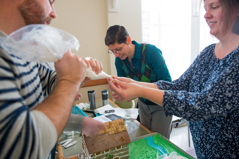 (Left to Right) Chris Linscott, Carrie Busch and Jennifer Romero work to construct the Office of Student Accessibilty's entry into the annual gingerbread decorating competition. Photo by Ben Siegel