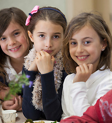 Scenes of  the Santa Rosa French-American Charter School in Santa Rosa,  California   Students smile together during their lunch time..