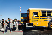 Students unload a school bus filled with school supplies donated by Wal-Mart at Randall Elementary School in Milpitas, California, on September 5, 2013. (Stan Olszewski/SOSKIphoto)