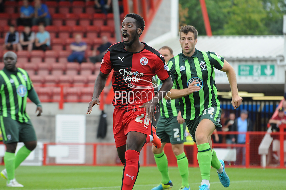 Roarie Deacon screams for the ball during the Sky Bet League 2 match between Crawley Town and AFC Wimbledon at the Checkatrade.com Stadium, Crawley, England on 15 August 2015. Photo by Michael Hulf.