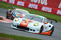 Michael Wainwright (GBR) / Adam Carroll (GBR) / Ben Barker (GBR) #86 Gulf Racing UK Porsche 911 RSR, during Free Practice 2  as part of the WEC 6 Hours of Silverstone 2016 at Silverstone, Towcester, Northamptonshire, United Kingdom. April 15 2016. World Copyright Peter Taylor. Copy of publication required for printed pictures.