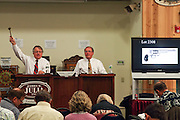 Auctioneers Jim Julia (l) and Dudley Browne at the October 2010 Firearms Auction.