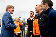 5-7-2016 AMSTERDAM - The King Willem Alexander is Tuesday July 5 attended the opening ceremony of the European Athletics Championships at the Museumplein in Amsterdam. During the opening ceremony wearing athletes of the 50 participating countries, the flag of their country. The flag of European Athletics, the European Athletics Federation, hoisted by two young talents. The King attends the opening ceremony and talks with several Dutch athletes. The European Athletics Championships, which wKing Willem-Alexander (L) of the Netherlands shakes hands with Britains Greg Rutherford next to Ellen van Langen (2nd L) of the Netherlands before the official opening ceremony of the European Athletics Championships 2016. as first organized in the Netherlands, finding 6 to July 10 in Amsterdam. COPYRIGHT ROBIN UTRECHT<br /> AMSTERDAM - de Koning Willem Alexander is dinsdagmiddag 5 juli aanwezig bij de openingsceremonie van de Europese Kampioenschappen atletiek op het Museumplein in Amsterdam Ellen van Langen Rutger Smith Churandy Martina Nadine Broersen . Tijdens de openingsceremonie dragen atleten van de 50 deelnemende landen de vlag van hun land. De vlag van European Athletics, de Europese atletiekfederatie, wordt gehesen door twee jeugdtalenten. De Koning woont de openingsceremonie bij en spreekt met een aantal Nederlandse atleten. De Europese Kampioenschappen atletiek, die voor het eerst in Nederland worden georganiseerd, vinden van 6 tot en met 10 juli plaats in Amsterdam.  COPYRIGHT ROBIN UTRECHT