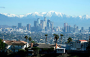 Snow mountains behind Los Angeles downtown skyline