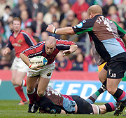 2004/05 Heineken_Cup, NEC,Harlequins vs Munster, RFU Twickenham,ENGLAND:.Munster's peter Stringer breaks Simon Maill's tackle, and starts to drop under the arm od Jon Dawson's challenge.  ..Photo  Peter Spurrier. .email images@intersport-images.com...