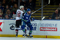 KELOWNA, BC - SEPTEMBER 29: Christian Fischer #36 of the Arizona Coyotes is checked by Erik Gudbranson #44 of the Vancouver Canucks during third peirod at Prospera Place on September 29, 2018 in Kelowna, Canada. (Photo by Marissa Baecker/NHLI via Getty Images)  *** Local Caption *** Erik Gudbranson;Christian Fischer