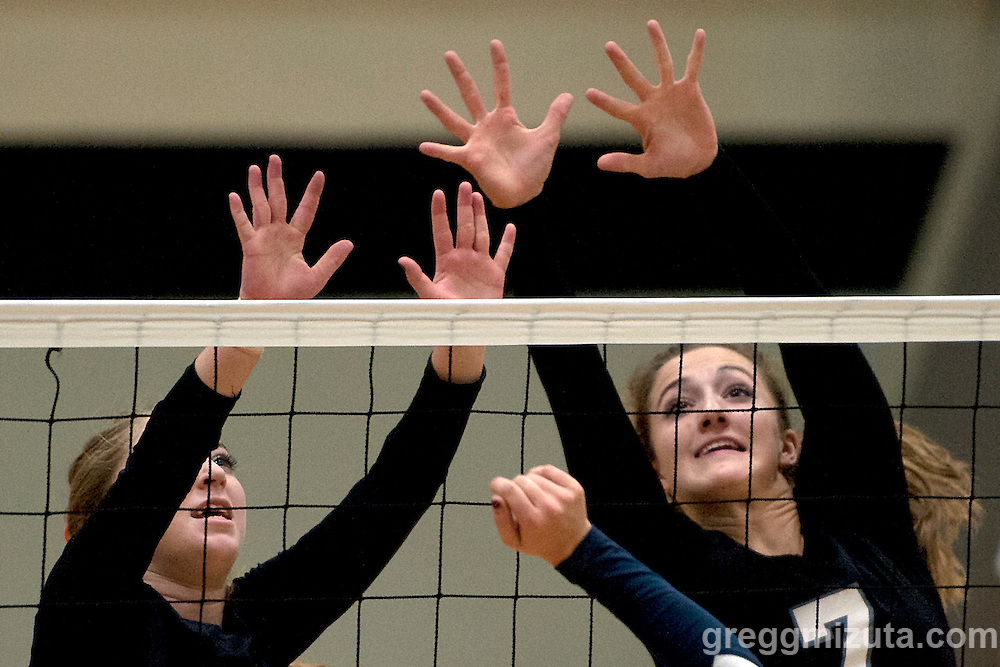 Vale Drew Dobney and Dallie Johnson block during the 2015 OSAA 3A Volleyball State Championship, Round 1, Vale - St. Mary's at  Vale High School, Vale, Oregon. October 31, 2015.<br /> <br /> Vale defeated St. Mary's of Medford in three games 25-10,  25-8, 25-13, improving their season record to 24-2.