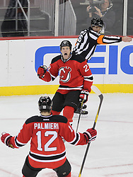 Nov 2; Newark, NJ, USA; New Jersey Devils right wing David Clarkson (23) celebrates his goal with New Jersey Devils right wing Nick Palmieri (12) during the second period at the Prudential Center.