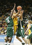 04 JANUARY 2007: Iowa guard Adam Haluska (1) drives in-between Michigan State center Goran Suton (14) and guard Travis Walton (5) in Iowa's 62-60 win over Michigan State at Carver-Hawkeye Arena in Iowa City, Iowa on January 4, 2007.