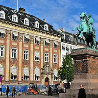Bishop Absalon Equestrian Statue in Copenhagen, Denmark <br /> This equestrian monument by Vilhelm Bissen is a tribute to Bishop Absalon, the founding father of Copenhagen.  In 1167, he constructed a castle named Kaufmanne Hafen which translates to Merchants Harbour.  From that humble beginning grew the city of København.  The statue, which was erected in 1901 on the 700th anniversary of Absalon's death, is at Højbro Plads. This square is surrounded by 18th and 19th century buildings. The one seen here at Gammel Strand 10 once headquarter the Kgl. Brand insurance company.  Today it is the law offices of Johan Schlüter Advokatfirma.