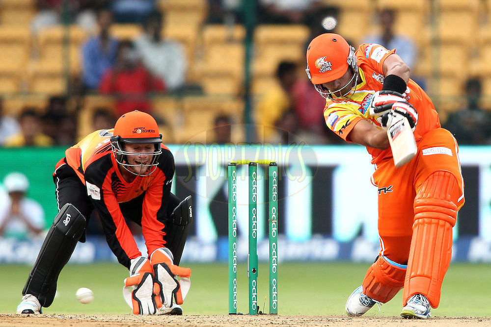Muhammad Umar Akmal of the Lahore Lions drives a delivery through the covers during match 19 of the Oppo Champions League Twenty20 between the Perth Scorchers and the Lahore Lions held at the M. Chinnaswamy Stadium, Bengaluru, India on the 30th September 2014<br /> <br /> Photo by:  Shaun Roy / Sportzpics/ CLT20<br /> <br /> <br /> Image use is subject to the terms and conditions as laid out by the BCCI/ CLT20.  The terms and conditions can be downloaded here:<br /> <br /> http://sportzpics.photoshelter.com/gallery/CLT20-Image-Terms-and-Conditions-2014/G0000IfNJn535VPU/C0000QhhKadWcjYs