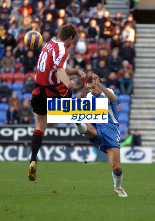 Photo: Paul Greenwood.<br />Wigan Athletic v Sheffield United. The Barclays Premiership. 16/12/2006. Sheffield's Michael Tonge, left, and Wigan's Josip Skoko both compete for the ball