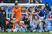 Cardiff City midfielder Marlon Pack (15) battles for possession with Birmingham City forward Lukas Jutkiewicz (10) during the EFL Sky Bet Championship match between Birmingham City and Cardiff City at the Trillion Trophy Stadium, Birmingham, England on 18 January 2020.