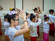 03 APRIL 2018 - CHIANG MAI, THAILAND: School girls rehearse a cultural dance with other girls and women in Chiang Mai. Songkran is the traditional Thai New Year festival and is celebrated April 13-15. The holiday is best known for raucous water fights but it is an important cultural and religious holiday.       PHOTO BY JACK KURTZ