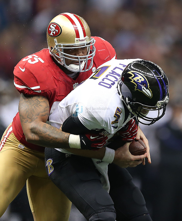 Joe Flacco (5) of the Baltimore Ravens is sacked by Ahmad Brooks (55) of the San Francisco 49ers during the NFL Super Bowl XLVII football game in New Orleans on Feb. 3, 2013. The Ravens won the game, 34-31.  (Photo by Jed Jacobsohn)