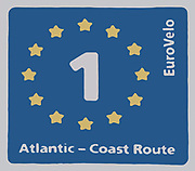 Sign for the EuroVelo 1 Atlantic coast cycling route. Following Europe's mighty western border, reaching from Scandinavia, to South and Western Portugal, the Atlantic Coast Route visits the majestic fjords of Norway, the wild Irish coastline, the rough cliffs of Brittany and the sun-kissed beaches of Portugal, totalling 9,100km.