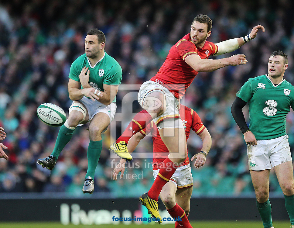 Dave Kearney of Ireland and George North of Wales during the RBS 6 Nations match at the Aviva Stadium, Dublin<br /> Picture by Lorraine O'Sullivan/Focus Images Ltd +353 872341584<br /> 07/02/2016