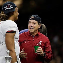 Jan 1, 2018; New Orleans, LA, USA; Alabama Crimson Tide head coach Nick Saban wears a hat backwards as he talks to quarterback Jalen Hurts (2) after the game against the Clemson Tigers in the 2018 Sugar Bowl college football playoff semifinal game at Mercedes-Benz Superdome. Mandatory Credit: Derick E. Hingle-USA TODAY Sports