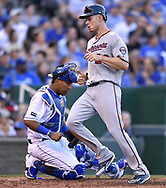 June 30, 2017 - Kansas City, MO, USA - The Minnesota Twins' Max Kepler scores in front of Kansas City Royals catcher Salvador Perez on a single by Miguel Sano in the third inning at Kauffman Stadium in Kansas City, Mo., on Friday, June 30, 2017. (Credit Image: © John Sleezer/TNS via ZUMA Wire)