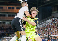 Football - 2018 / 2019 EFL Carabao Cup (League) Cup - Fulham vs. Exeter City<br /> <br /> Matt Jay (Exeter FC) whinces as Calum Chambers (Fulham FC) collides with him as they both challenge for the ball at Craven Cottage.<br /> <br /> COLORSPORT/DANIEL BEARHAM