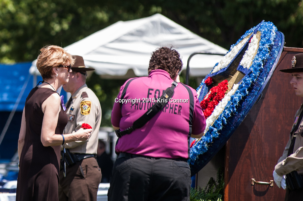 "Maura Kelley lays a flower during the 34th Annual National Peace Officers Memorial Service to remember her late husband Ventura County sheriff's deputy Yehven ""Eugene"" Kostiuchenko at the west lawn of the U.S. Capitol on May 15, 2015. Yehven, a Ukrainian hit by a drunk driver last October who came to the U.S. to investigate a money laundering case and met his future wife. Photo by Kris Connor"