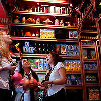 ORLANDO, FL -- May 29, 2010 -- Christina Currais, left to right, Amanda Ramirez, Yasmine Morris, and Yanel De Los Santos, all of Miami gaze up at Zonko's magic shop at The Wizarding World of Harry Potter at Universal Orlando in Orlando, Fla., on Saturday, May 29, 2010.  The 20-acre park features a new ride inside the Hogwarts Castle, shops along the village of Hogsmeade, and is scheduled to officially open on June 18.