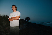 Mark Dodd, State Sea Turtle Program Coordinator of the Georgia Department of Natural Resources, waits for the tide to recede before the start of a night of searching, tagging, and gathering data from nesting sea turtles on Ossabaw Island, Georgia, June 17 and 18, 2012.