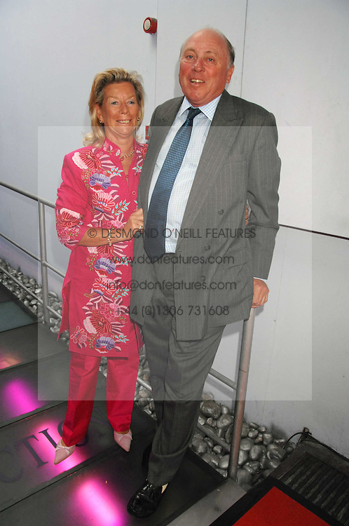 MAJOR &amp; MRS CHRISTOPHER HANBURY at the Cartier Polo Players' Party in association with the Hurlingham Polo Association held at The Collection, London SW3 on 24th July 2007.<br />