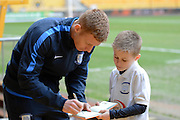 Preston North End striker Paul Gallagher signs and autograph for a fan during the Sky Bet Championship match between Wolverhampton Wanderers and Preston North End at Molineux, Wolverhampton, England on 13 February 2016. Photo by Alan Franklin.