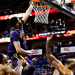 Feb 6, 2017; New Orleans, LA, USA; New Orleans Pelicans forward Anthony Davis (23) dunks over Phoenix Suns forward P.J. Tucker (17) and guard Brandon Knight (11)during the second quarter of a game at the Smoothie King Center. Mandatory Credit: Derick E. Hingle-USA TODAY Sports