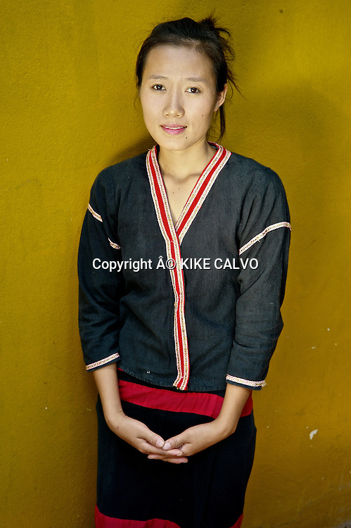 Young girl wearing a Khmu country side traditional dress in Laos.