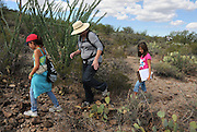 Pamela Pelletier, (center), leads students from Drachman Elementary School on a cactus count at the Desert Laboratory at Tumamoc Hill at the University of Arizona, Tucson, Arizona, USA.
