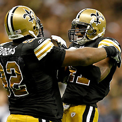 September 25, 2011; New Orleans, LA, USA; New Orleans Saints defensive tackle Shaun Rogers (92) and safety Roman Harper (41) celebrate during the fourth quarter against the Houston Texans at the Louisiana Superdome. The Saints defeated the Texans 40-33. Mandatory Credit: Derick E. Hingle