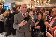 ALAN MONTAGUE-LEWIS,  SERVING BOLLINGER, David Campbell Publisher of Everyman's Library and Champagen Bollinger celebrate the completion of the Everyman Wodehouse in 99 volumes and the 2015 Bollinger Everyman Wodehouse prize shortlist. The Archive Room, The Goring Hotel. London. 20 April 2015.