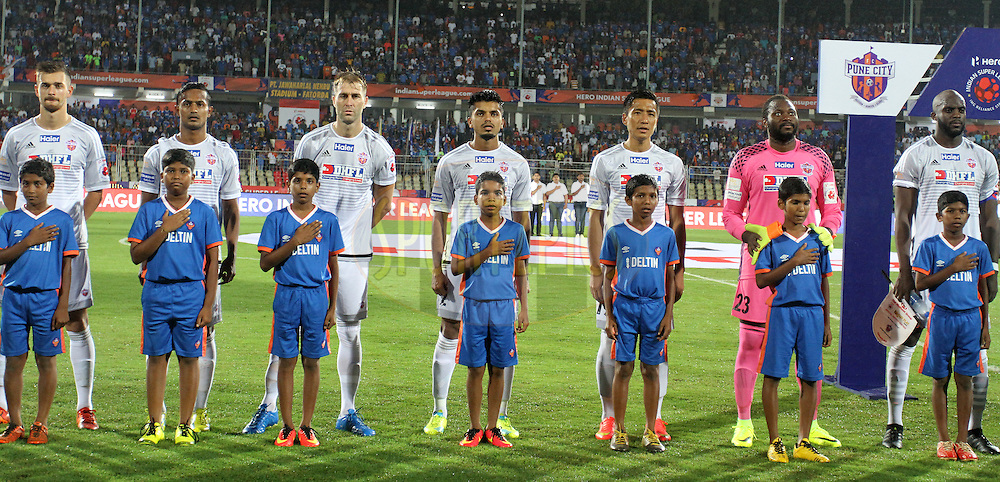 FC Pune City players stand for the national anthem during match 8 of the Indian Super League (ISL) season 3 between FC Goa and FC Pune City held at the Fatorda Stadium in Goa, India on the 8th October 2016.<br /> <br /> Photo by Vipin Pawar / ISL/ SPORTZPICS