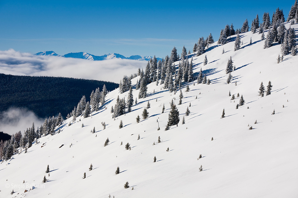 The long snow-covered slopes in front of the Fowler-Hillard Yurt in the Vail Pass Winter Recreation area.