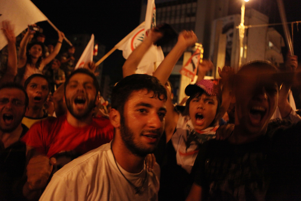 "As the results started to come out from Lebanon's general elections, the Beirut 1 district appeared to be swept by Christian groups from the pro-western ""March 14"" alliance. As exit polls projected the win for March 14, supporters of the Lebanese Forces and Phalange parties came out to the Ashrafiyeh neighborhood's Sassine Square to celebrate. At around 1am Nadim Gemayel made a suprise appearance and briefly addressed supporters. Nadim Gemayel is the son of the Phalange party founder, Pierre Gemayel. Nadim's father, Bashir was assasinated in 1982 during the Lebanese civil war and remains one of the most popular icons of many of the Lebanon's Maronite Christians. The 27-year-old Nadim Gemayel will be one of Lebanon's youngest parliamentarians. The celebrations at Sassine were one of Lebanon's first celebrations after the elections ended on 7 June. ///March 14 alliance supporters celebrate their victory in the elections at Beirut's Sassine Square."