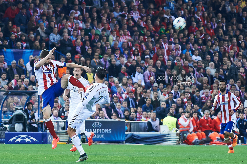 Cristiano Ronaldo (Real Madrid F.C.) and Gabi in action during the Champions League, round of 4 match between Atletico de Madrid and Real Madrid at Estadio Vicente Calderon on April 14, 2015 in Madrid, Spain