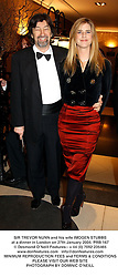 SIR TREVOR NUNN and his wife IMOGEN STUBBS at a dinner in London on 27th January 2004.PRB 167