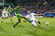 Forest Green Rovers Kaiyne Woolery(14) crosses the ball under pressure from Tranmere Rovers Steve McNulty(5) during the Vanarama National League match between Tranmere Rovers and Forest Green Rovers at Prenton Park, Birkenhead, England on 11 April 2017. Photo by Shane Healey.