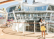 Royal Caribbean, Harmony of the Seas, Stretching the length of the ship, the Pool and Sports Zone is an ample playground for guests of all ages, featuring four unique types of pools, two FlowRider surf simulators, a zip line, amazing views of Boardwalk and Central Park below, plus the introduction of a trio of water slides as well as the Ultimate Abyss. plus bars and afternoon lice concerts